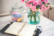 Calendar and vase of flowers on a desk