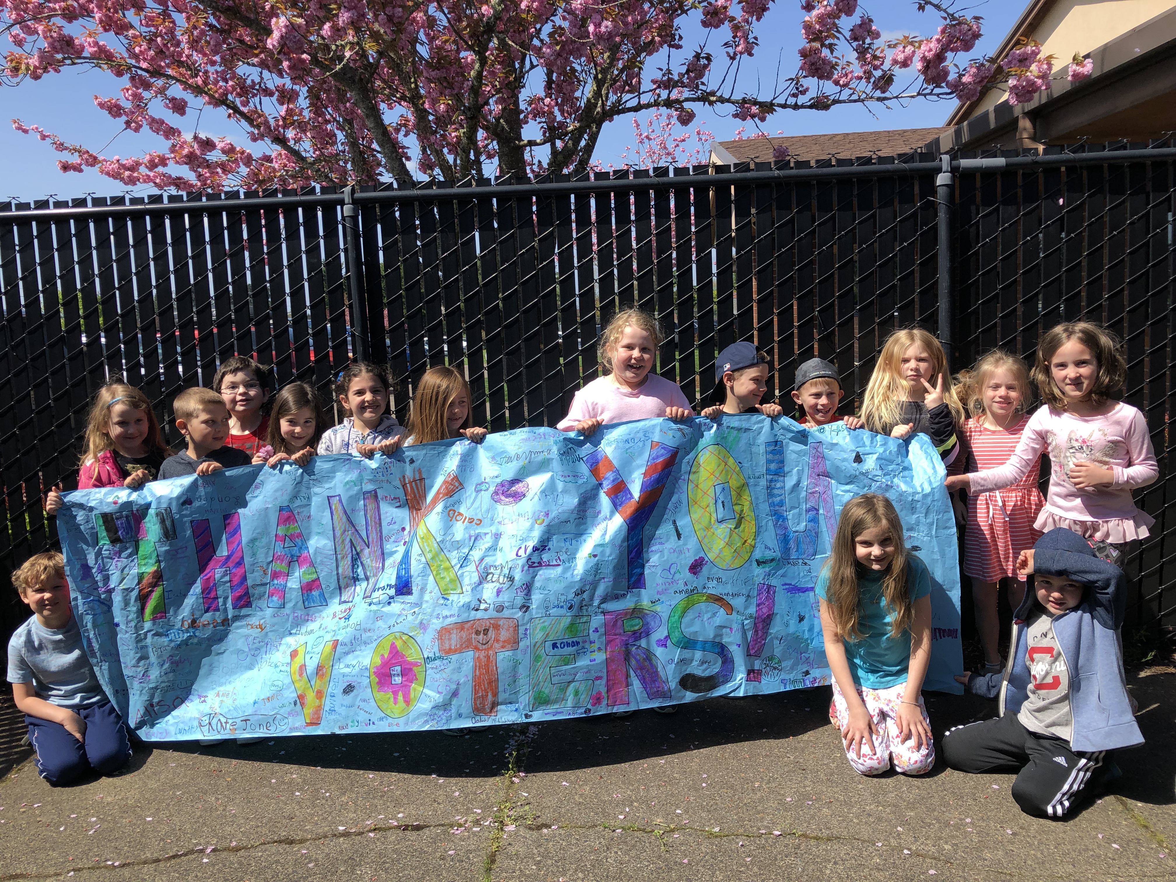 "Hockinson students hold a sign that says, ""Thank you, Hockinson voters!"""